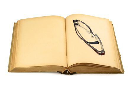 open old blank book with glasses on white background photo