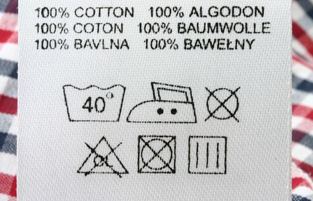 guideline: 100% cotton  - real macro of clothing labe