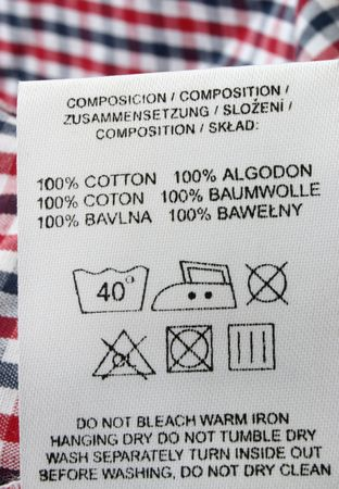 clothing label: 100% cotton  - real macro of clothing label