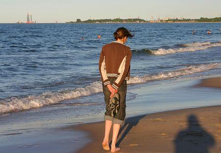 stroll: photo of female during summer beach stroll