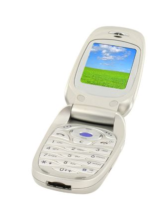close-up of flip phone with summer landscape, photo inside is my property Stock Photo