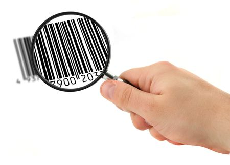hand with magnifying glass scanning bar code (bar code is FAKE, no copyright infringement) photo
