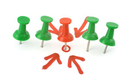 target concept  #2 - thumbtack placed in the centre, four red arrows pointing at it Stock Photo