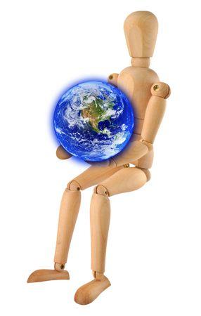 wooden figure: wooden figure holding glowing earth in hands