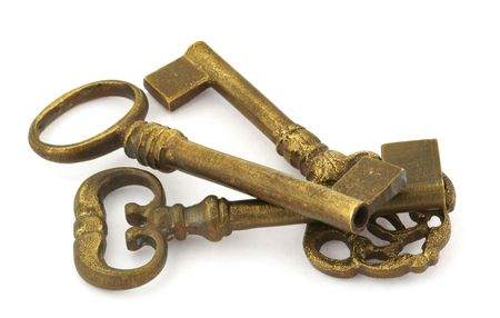 tarnish: close-up of three ornamented old keys isolated on white background  Stock Photo