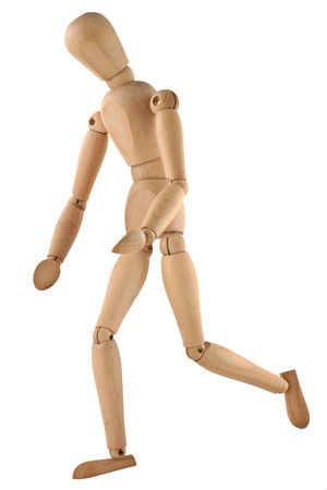 wooden figure: close-up of a running wooden figure isolated on pure white background Stock Photo