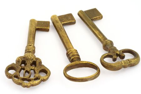 three objects: close-up of three ornamented old keys isolated on white background  Stock Photo