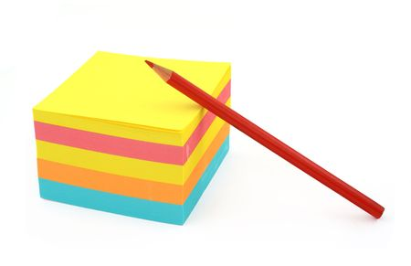 memorise: blank adhesive notes and red crayon against white background Stock Photo