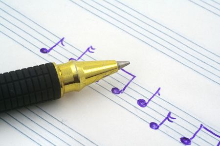 hand written: close-up of hand written music note and ballpoint pen tip  Stock Photo