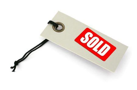 sold small: VENDUTO etichetta con iscrizione nei confronti di bianco, una piccola ombra in virt� di esso, non violazione del diritto d'autore  Archivio Fotografico