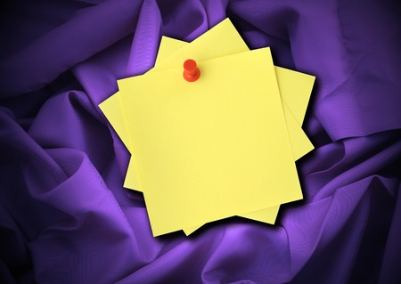 sateen: close-up of purple satin and blank adhesive notes Stock Photo