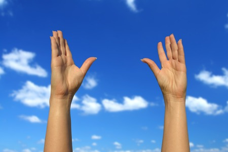 striving: photo of female hands trying to reach the sky  Stock Photo
