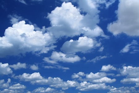 summer sky background with beautiful massive cumulus clouds Stock Photo