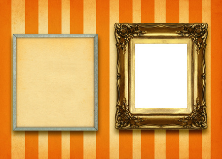 hollow wall: hollow gilded picture frame and empty pinboard against striped wall