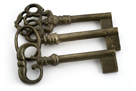 ornamented: close-up of three ornamented old keys isolated on white background  Stock Photo