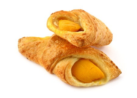 french pastry: close-up of two French pastry apricot cakes against white background