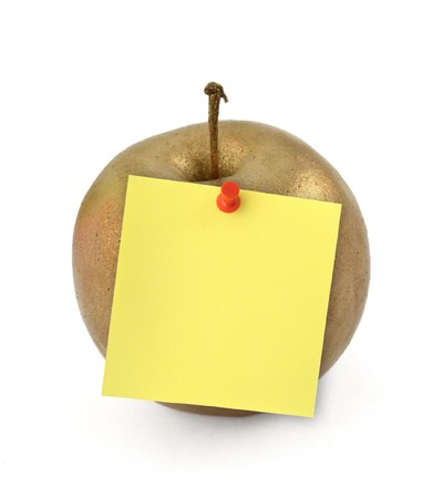 thumbtacked: close-up of golden apple with yellow note