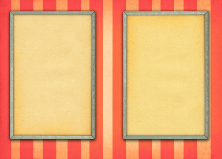 two empty frames on retro background with stripes photo