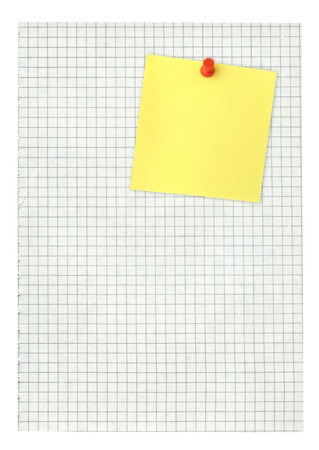 thumbtacked: adhesive note thumbtacked to squared paper page on white
