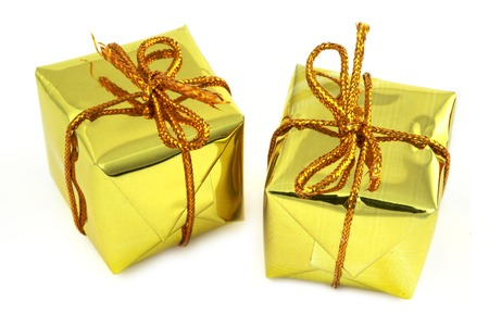 close-up of two golden gifts isolated on white photo
