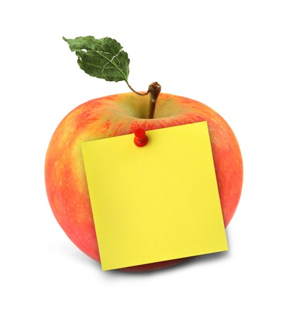 close-up of delicious apple with yellow note
