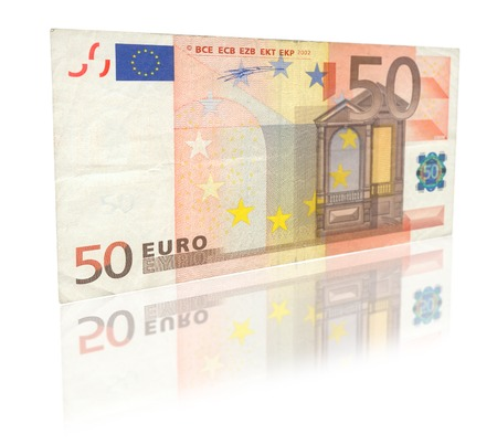 50 euro: close-up of 50 Euro banknote with reflection against white