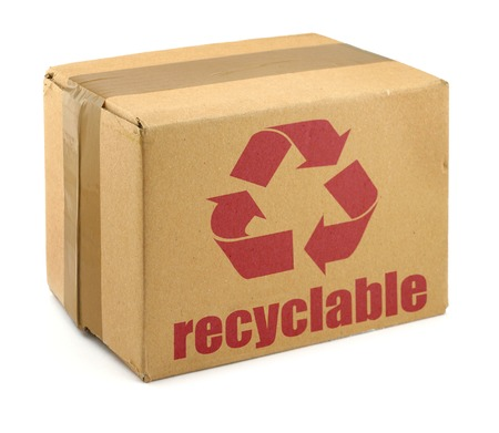 close-up of cardboard box with recyclable symbol against white background
