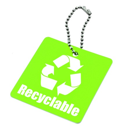 pricetag: close-up of green tag with recyclable symbol isolated on white background
