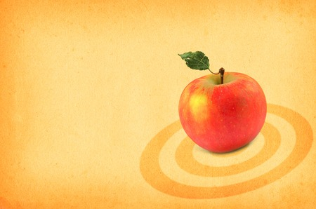 close-up of red apple against retro paper background Stock Photo - 1613235