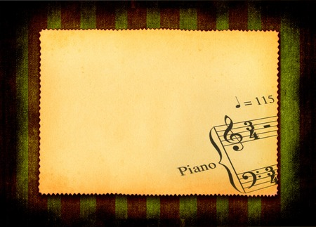 scabrous: sheet of old paper with part of music note, all against grunge dark background Stock Photo