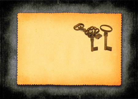 ornamented: sheet of old paper with retro ornamented keys