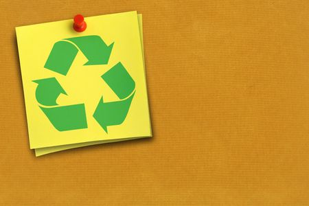 thumbtacked: green recycling symbol on yellow note against cardboard background