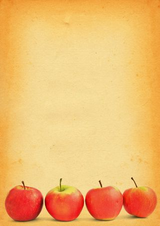 group of red apples against old stained paper  photo