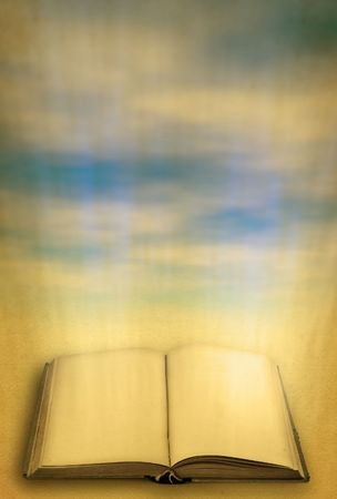 lightbeam: open holy book against heaven, focus is set in foreground