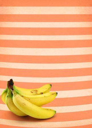 bunch of ripe bananas against retro background Stock Photo