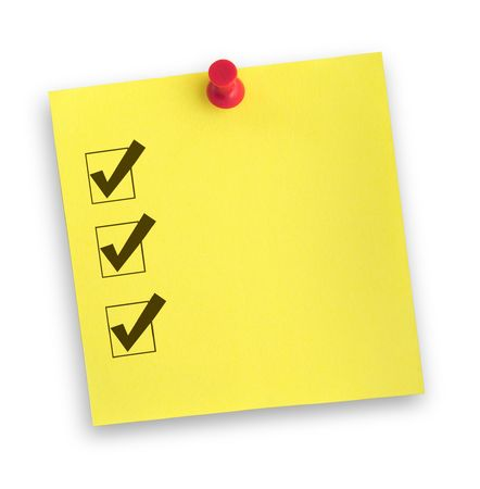 yellow adhesive note with completed checklist against white, gentle shadow underneath photo