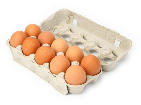 ten eggs in a box against white background, natural  shadow in front and  behind the open lid  Stock Photo - 1990329