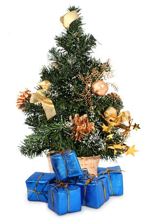 toygift: christmas tree and gifts against white background, focus set in foreground