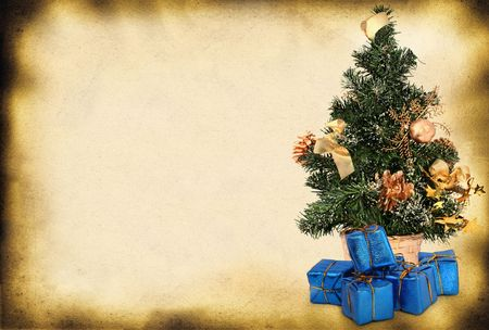 toygift: christmas tree and presents against old paper page