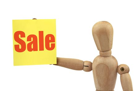 wooden figure holding a sale announcement isolated on white background