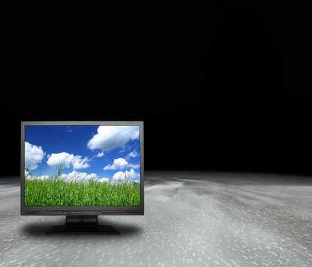 lcd screen with grassland on an abstract planet, photo inside is my property, you can also remove the wallpaper and use as needed Stock Photo - 2086878