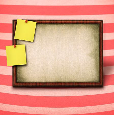 thumbtacked: wooden frame and to yellow notes against striped background Stock Photo