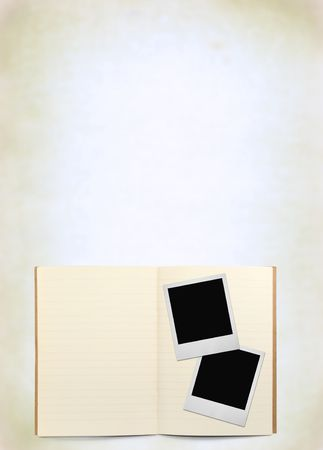 lined exercise book and two photo frames, natural shadow in front photo