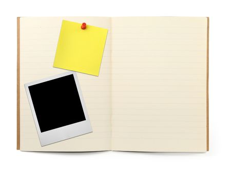 lined exercise book with photo frame and yellow note, visivle natural shadow in front photo