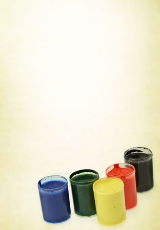group of paint cups against abstract background with vignette photo
