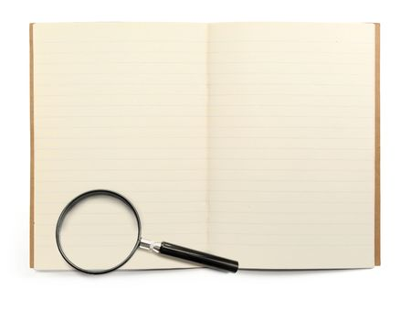 blank lined exercise book and magnifying glass on white, visible shadow in front photo