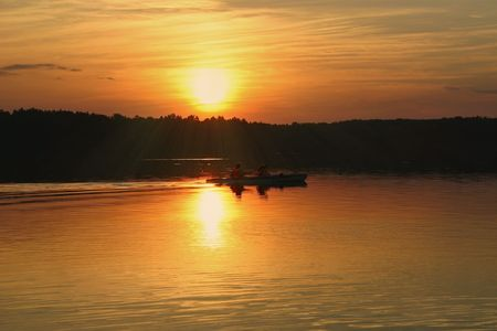 two kayakers against beautiful summer sunset Stock Photo - 2354050