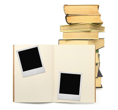 lined exercise book and two photo frames on white, stack of books in background,  visible shadow in front photo