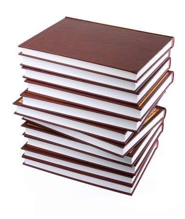 educating: stack of books against white background Stock Photo