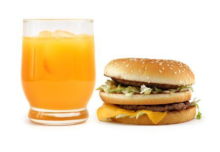 hamburger and orange juice on white background, minimal natural shadow in front photo